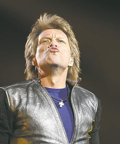 Jon Bon Jovi air-kisses some fans.