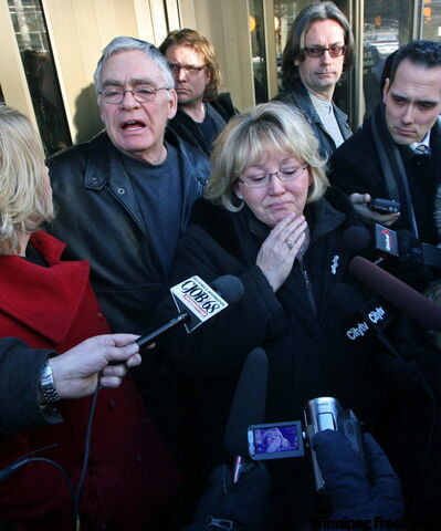 Jan Frizzley (centre) and husband Craig (left) talk to reporters about the outcome of the court case against Steve Watkins, who pleaded guilty this morning to impaired driving causing the death in 2007 of their daughter, Amanda.