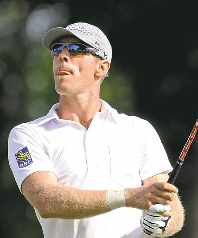 Fred Beckham / the associated pressLong-hitting Canuck Graham DeLaet thunders a tee shot on the 18th hole Saturday.
