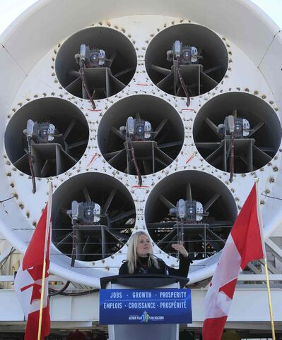 Michelle Rempel, Minister of State for Western Economic Diversification, speaks in front of the GE Aviation Engine Testing Research and Development Centre in Winnipeg.