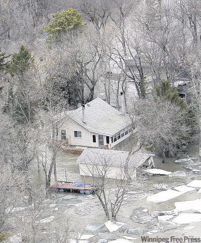 Houses and cottages in the Breezy Point area were submerged under frigid river water.