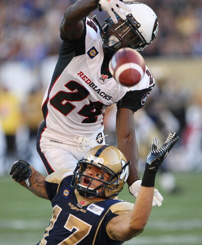 The Bombers' Nick Moore gets stripped of the ball during a second-quarter pass attempt by the Ottawa Redblacks' Jerrell Gavins Thursday evening.