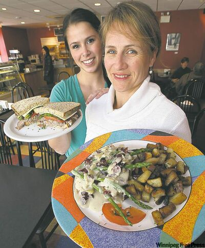 Maya Torres-Garner with roast beef sandwich and Larissa Webster (front) with turkey baguette at Frenchway.