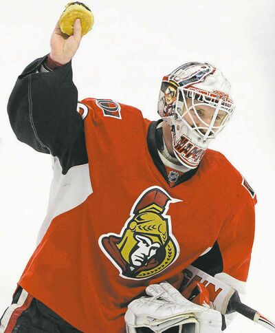 CLOSECUT CLOSE CUTOttawa Senators' Andrew Hammond, nicknamed 'The Hamburglar' holds up a hamburger after it was thrown on the ice after he defeated the Philadelphia Flyers 2-1 in the shootout in NHL hockey action in Ottawa on Sunday, March 15, 2015. THE CANADIAN PRESS/Sean Kilpatrick