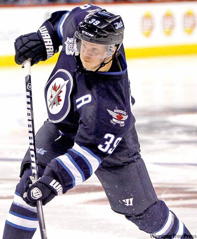 Jet Tobias Enstrom takes a shot during second-period action. Winnipeg jets take on the Montreal Canadiens for the NHL regular season home opener Sunday, October 9, 2011 at the MTS Centre.