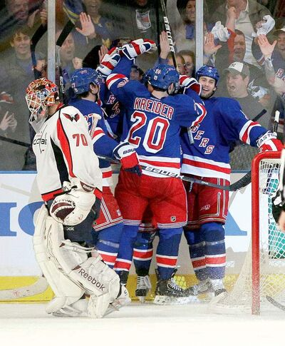 Capitals goalie Braden Holtby skates away in disgust as the Rangers celebrate a third-period goal by Brad Richards.