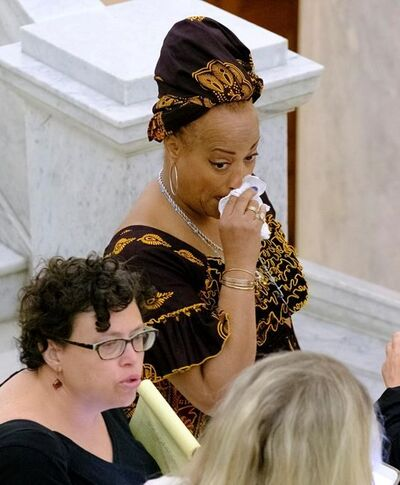 One of Bill Cosby's accuser's reacts at the Montgomery County Courthouse after a mistrial the Bill Cosby sexual assault case in Norristown, Pa., Saturday, June 17, 2017. Cosby's trial ended without a verdict after jurors failed to reach a unanimous decision. (Ed Hille/The Philadelphia Inquirer via AP, Pool)