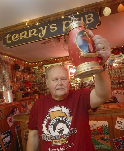 Terry Mitchell toasts his extensive collection of German-style beer steins with one of his favourites, which includes a painted image of a Mountie.</p></p>