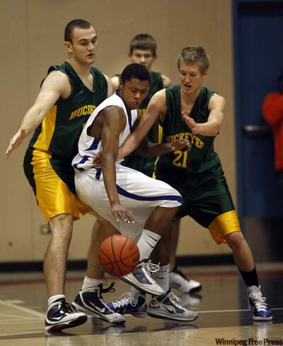 Oak Park's Elliot Taylor (centre) runs into a wall of Miles Macdonell Buckeyes defenders at the Wesmen Classic Monday.