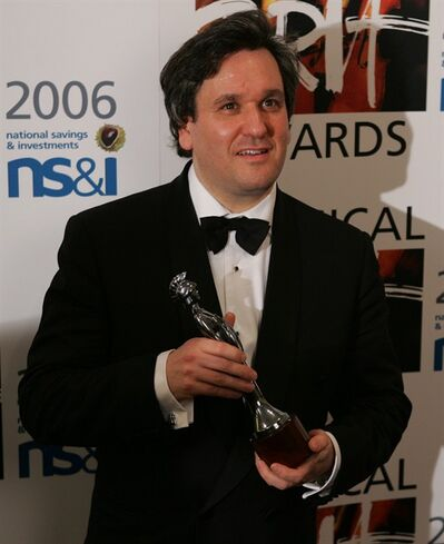 "FILE - Antonio Pappano holds the Critic's Choice Brit award at the Brit Classical Music Awards at the Royal Albert Hall in London in this Thursday May 4, 2006 file photo. Modern-day singers lack commitment and stamina compared to previous generations of performers Pappano, the music director of London's Royal Opera House, said Wednesday March 13 2013. Singers ""are either weaker in their bodies or don't care,"" and need more periods of rest than previous generations.(AP Photo/Alastair Grant)"