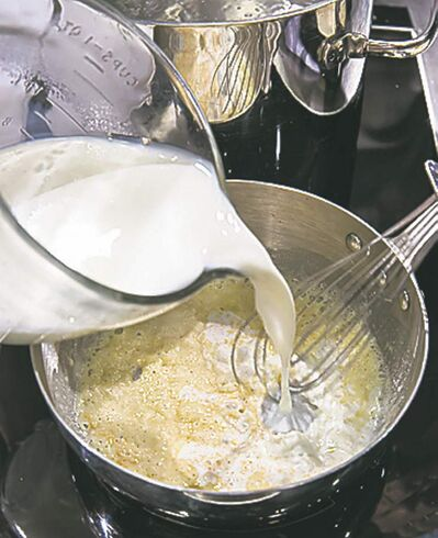 The key to a velvety-smooth cheese sauce that coats the pasta and other ingredients uniformly is a simple roux.
