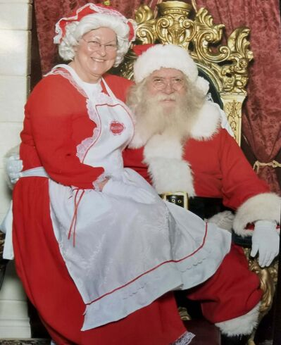 "A Calling card photo of Brian ""Santa"" Sanderson with Lillian Hallaren-Harrison his partner of 11 years. (Supplied)</p></p>"