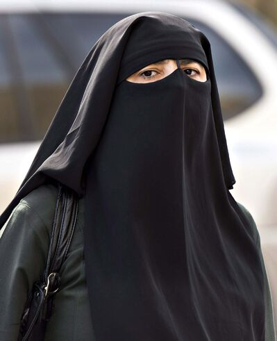 RYAN REMIORZ / CANADIAN PRESS FILES</p><p>A woman wears a niqab as she walks in Montreal.</p>