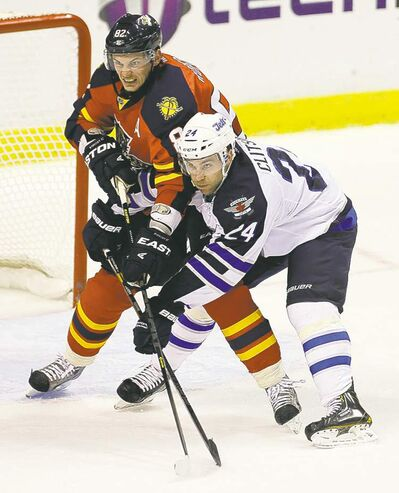 The Panthers' Tomas Kopecky (left) and the Jets' Grant Clitsome jostle for position in front of the goal during the first period Tuesday evening.