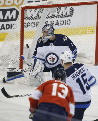 <p>Florida Panthers defenseman Mark Pysyk scores a goal against Winnipeg Jets goalie Eric Comrie during the first period.</p>