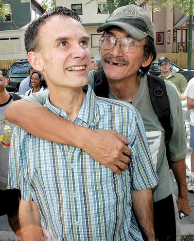KEN GIGLIOTTI / WINNIPEG FREE PRESS FILES</P><p>Lehotsky gets a hug from longtime friend Jerry Woodhouse at the unveiling of the Lehotsky tribute mural in July 2006. Woodhouse had worked on projects with Lehotsky for more than a decade.