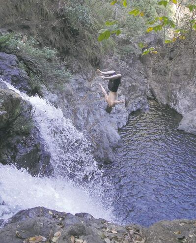 Wesley Dodds, visiting from Oregon, backflips off a cliff at Montezuma Falls.