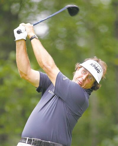 Stew Milne / the associated pressPhil Mickelson thunders a drive on the second hole at TPC Boston.
