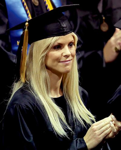 "Elin Nordegren claps during commencement ceremonies at Rollins College in Winter Park, Fla., Saturday, May 10, 2014. Nordegren, the former wife of golfer Tiger Woods, was named the ""Outstanding Graduating Senior"" for Rollins College. (Stephen M. Dowell/Orlando Sentinel/MCT)"