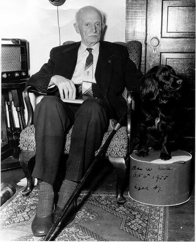 Former federal and provincial politician Alan Webster Neill sits with his dog in a photo from 1955 at the age of 87. The Alberni School District in B.C. is preparing a public consultation for the renaming of A.W. Neill Elementary School, over Neill's support of anti-Chinese laws in the legislature and his approval of Indigenous residential schools. THE CANADIAN PRESS/HO-Alberni Valley Museum Photograph PN1247 *MANDATORY CREDIT *
