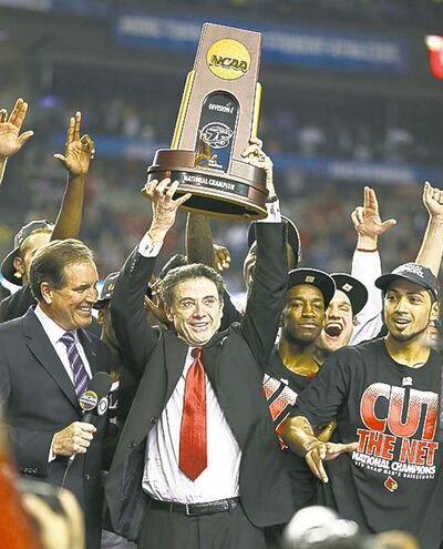 Louisville Cardinals players and head coach Rick Pitino celebrate during the post-game ceremonies, after defeating Michigan, 82-76, in the NCAA Men's Basketball Championship at the Georgia Dome in Atlanta, Georgia, Monday, April 8, 2013. (Mark Cornelison/Lexington Herald-Leader/MCT)