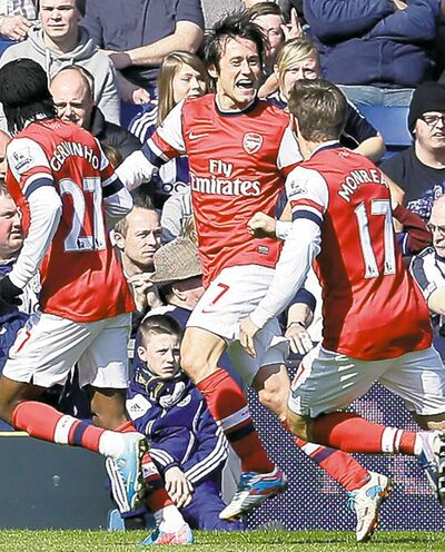 Arsenal's Tomas Rosicky (centre) celebrates after scoring a goal against West Bromwich Albion.