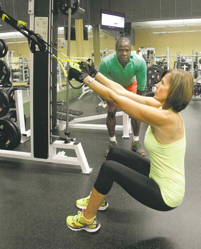 Wayne Glowacki / Winnipeg Free Press  Aline Sawchyn, 56, has been working out under Valentine Payne's guidance for the last two years. In her first eight weeks, she lost 22 pounds and 20 inches.