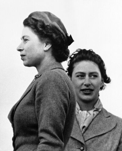 The Associated Press files</p><p>Andrew Morton accessed countless anecdotes and recollections from former staff, current courtiers and old flames in his biography of Queen Elizabeth II (left) and Princess Margaret, seen here in 1955. </p>