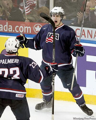 Team USA forward Chris Kreider (right) celebrates his second goal of the game with teammate Kyle Palmieri.