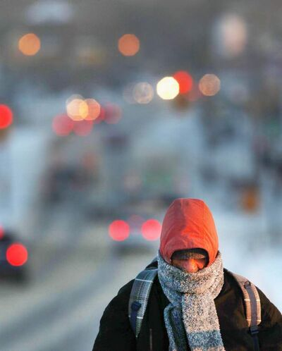 A pedestrian makes the long walk over the Slaw Rebchuk bridge in Winnipeg  on a cold Thursday morning.