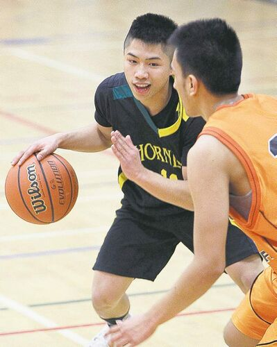 Tec Voc Hornets guard Arenz Tabianin plays against the  St. John�s Tigers Monday. He�s the last of the Tabianin brothers, and when he leaves Tec Voc will be ending a long family tradition.