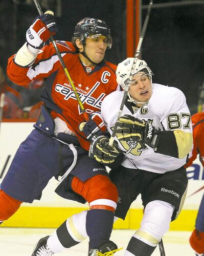 Capitals' Alex Ovechkin hits Penguins centre Sidney Crosby during the Caps' 5-2 loss Thursday.