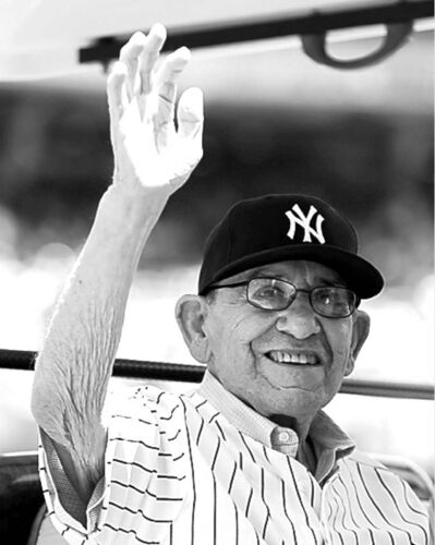 Hall of Fame catcher Yogi Berra  arrived dressed much like he did in his playing days from 1946 to 1963.