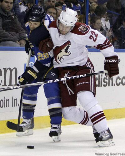St. Louis Blues' Carlo Colaiacovo, left, and Phoenix Coyotes' Lee Stempniak chase a loose puck during the first period of an NHL hockey game Monday.