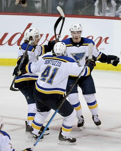 St Louis Blues' Tyler Bozak celebrates with Robert Bortuzzo and Robert Thomas after scoring the game-winning goal against the Winnipeg Jets late in the 3rd period, Wednesday.