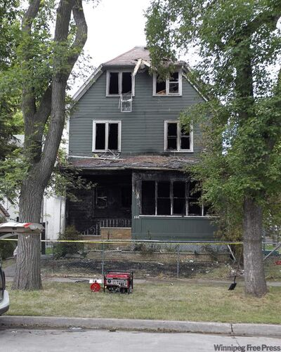 The remains of a rooming house on Austin Street North where fire killed five people.