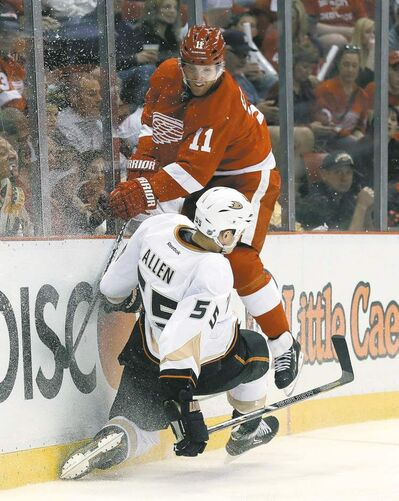 Red Wings right-winger Daniel Cleary (11) collides with Anaheim Ducks defenceman Bryan Allen.