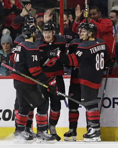 The Carolina Hurricanes have come up with a unique celebration, dubbed a Storm Surge, following each home win. (Luis M. Alvarez / The Associated Press files)</p>