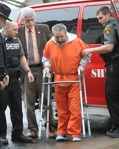 In this Dec. 12, 2012 file photo, members of the Seneca County Sheriff's Department assist Karl Karlsen as he arrives for his court appearance at the Seneca County Courthouse in Waterloo, N.Y. Karlsen collected $200,000 from his first wife's insurance policy when she died in a 1991 house fire and another $700,000 when his grown son's pick-up truck slipped off its jack and killed him. When Karlsen's latest wife found out that he had taken out a $1.2 million insurance policy on her, she went to the police fearing that she would be the next death in the family. (AP Photo/The Post-Standard, Stephen D. Cannerelli)
