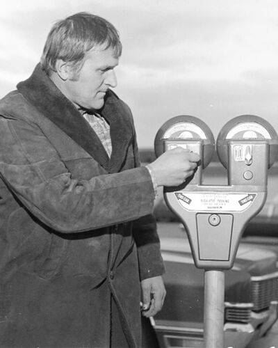 Steinbach Councillor Helmut Pankratz feeds a brand new parking meter on the parking lot of the Steinbach Civic Centre in 1976.