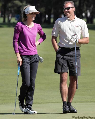 LPGA star Anna Rawson chats with Jeff Pries during the Pro Am at St. Charles Country Club on Wednesday.