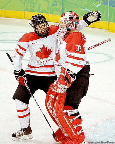 Becky Kellar, goalie Charline Labonte celebrate 13-1 victory over Sweden.