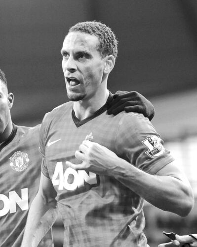 Clint Hughes / The Associated PressManchester United�s Rio Ferdinand walks off the pitch after being hit in the face by a coin thrown from the crowd Sunday. Nine men were charged in connection with the derby disorder Monday.