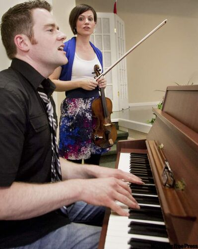 Shane Wiebe rehearses with his wife Angela. The Wiebes are on tour supporting their CD Restore the Wonder. Wiebe credits his stint on Canadian Idol 2 for showing him he could make a career out of singing.