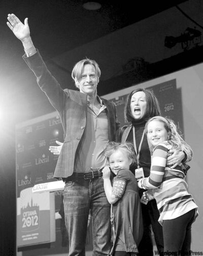 SEAN KILPATRICK / THE CANADIAN PRESSNew Liberal Party of Canada president Mike Crawley celebrates with wife Heather, daughters Paige (right) and Meghan at the convention in Ottawa Sunday.