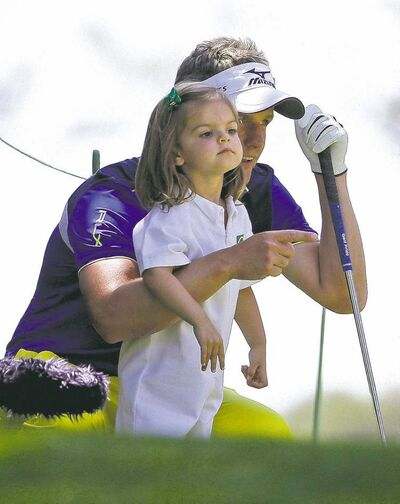 Luke Donald talks to his daughter Sophia during the Par 3 Contest Wednesday. On the last hole, he turned putting over to his daughter Elle, 3, who two-putted.