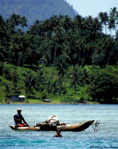 Fishing off the island of New Britain, Papua New Guinea, near Kimbe Bay.