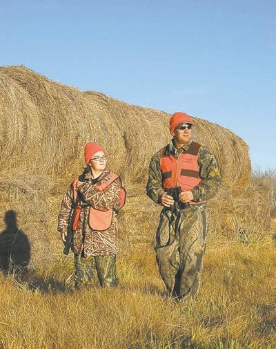 Kevin Zazulinski and his daughter, Jada, prepare for an early-season deer hunt.