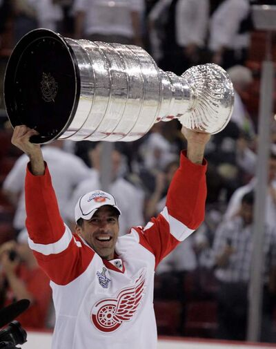Detroit Red Wings defenceman Chris Chelios holds the Stanley Cup after the Red Wings defeated the Pittsburgh Penguins in Game 6 of the Stanley Cup finals in Pittsburgh in 2008.