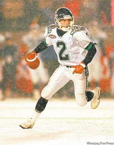 FILE - This Nov. 24, 1996, file photo shows Toronto Argonauts� quarterback Doug Flutie scrambling against the Edmonton Eskimos during first half action at the Grey Cup in Toronto. (Frank Gunn / The Canadian Press Archives)
